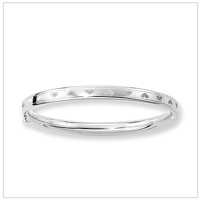 14kt white gold bangle bracelet with hearts all around. Safety clasp. Cild size 5.25 in. bangles.