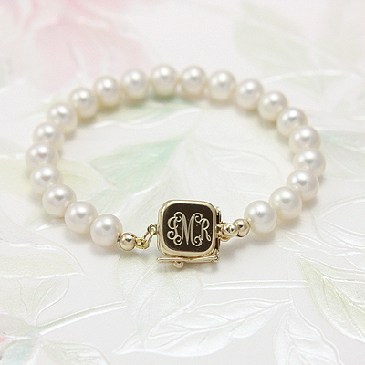 Fine cultured pearl baby bracelets. Custom engraving on the safety clasp.