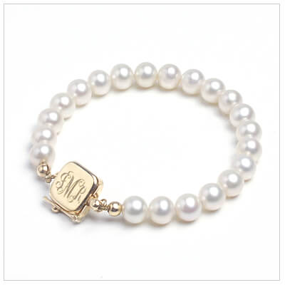 Babys First Pearls bracelet in white cultured pearls with 14kt gold clasp personalized with engraving.