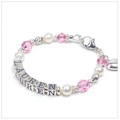 Girls pearl bracelet personalized with name and birthstone crystals.
