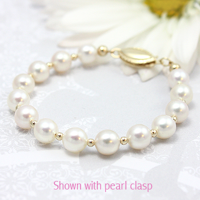 Girls white pearl bracelet with 14kt gold beads and clasp.