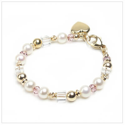 Gold baby and child bracelet with polished beads, white pearls, and sparkling crystal.