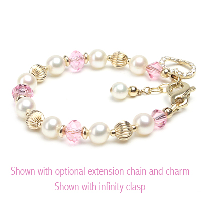 14kt gold baby bracelet with white cultured pearls and pink Swarovski crystal.