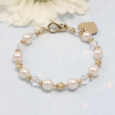 14kt gold baby bracelets with cultured pearls, clear Swarovski crystals, and sparkling diamond cut gold beads.