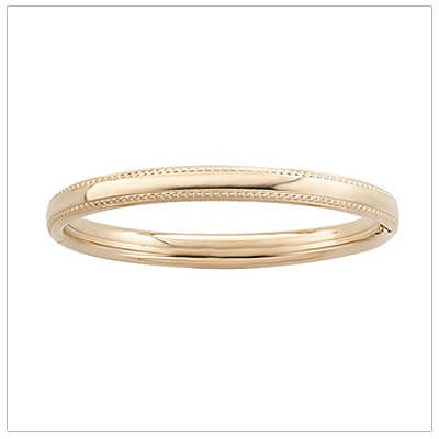 14kt gold filled bangle bracelet for children with a beaded border top and bottom.