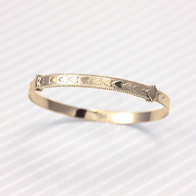 14kt gold filled baby bangles with heart border and adjustable sizing. Fits baby, toddler, and child.