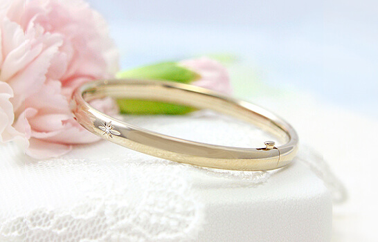 14kt gold filled bangle bracelet with genuine diamond.