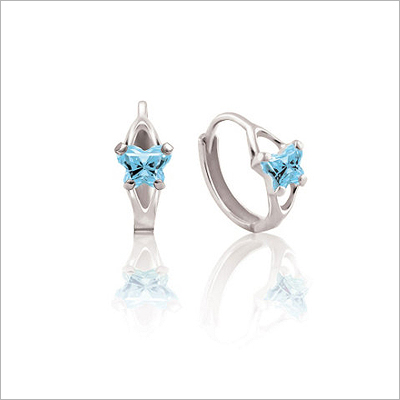 White gold children's huggie earrings with butterfly shaped birthstones.