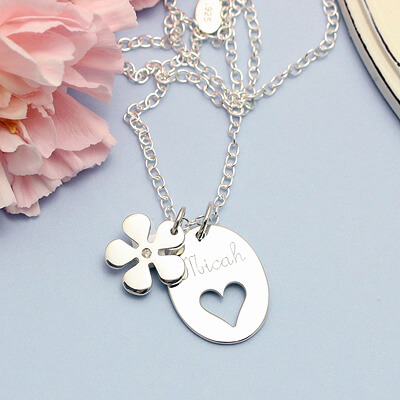 Sterling engraved necklaces with a heart cut out and diamond flower charm. Chain included. Kids jewelry