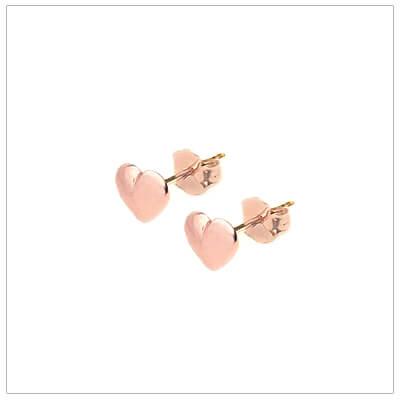 Rose gold heart earrings for children with push on backs.