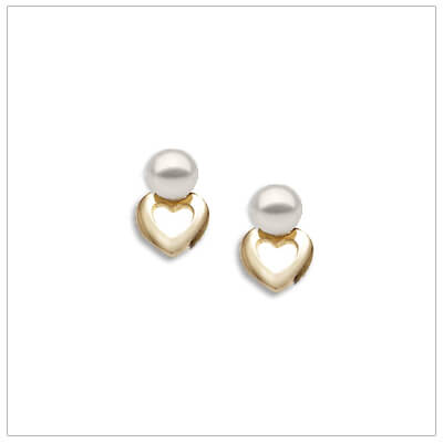 14kt gold heart childrens earrings set with white pearls. Our childrens earrings are screw backs.