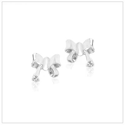 Charming 14kt white gold bow earrings for babies and children set with a small cubic zirconia. Screw back earrings for children.