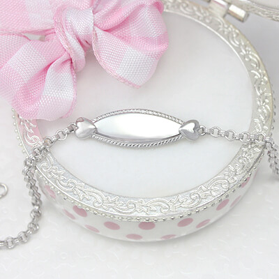 Precious id bracelet for kids in sterling silver with two hearts and beaded trim.