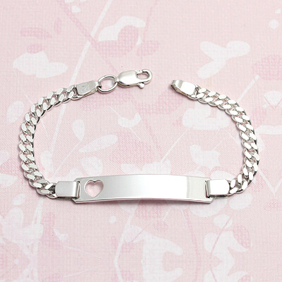 Girls silver id bracelet with a heart cut out and curb chain. Front engraving included.