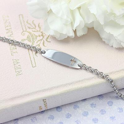 Cross cut out id bracelet for kids in sterling silver.