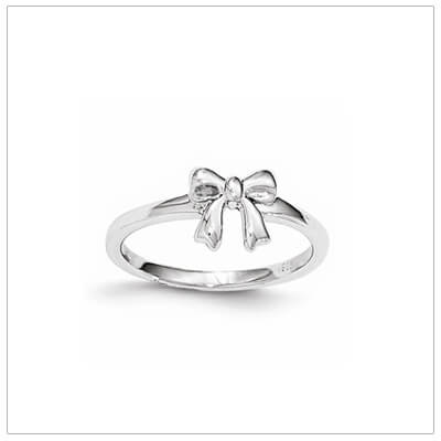 Adorable silver bow ring for children; our kids ring is available in 2 sizes.