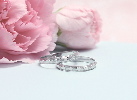 Adorable silver band rings with a heart design all around the band.