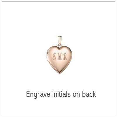 Gold heart locket back with engraved initials.
