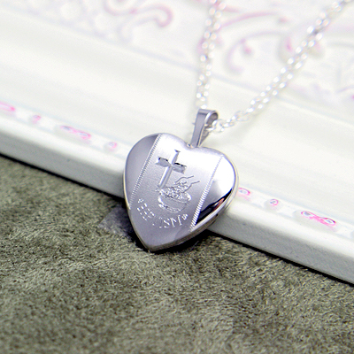 Silver Baptism locket necklace engraved with a Cross and baptism symbols. The heart locket holds two photos and can be custom engraved on the back.