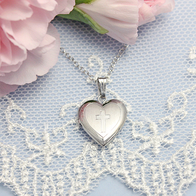 Sterling silver heart locket with engraved Cross on front, custom engrave initials on the back.