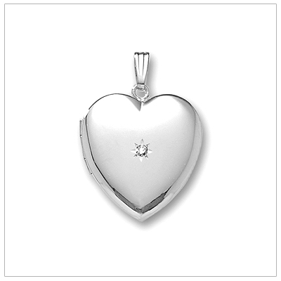 Elegant locket necklace in polished sterling silver. The heart locket is set with a genuine diamond.