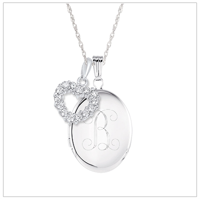 Oval locket necklace in sterling silver personalized with custom engraving. The necklace includes a sterling rope chain.