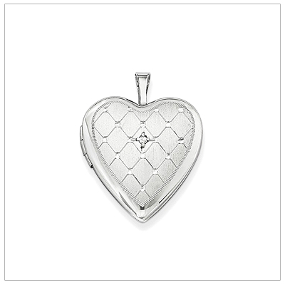 Heart locket in sterling silver engraved with a quilted pattern and set with genuine diamond.
