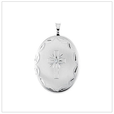 Oval shaped silver locket engraved with a Cross. The Cross is set with a diamond and the locket holds 2 photos.