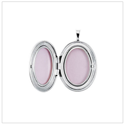 The silver locket opens to hold two photos.
