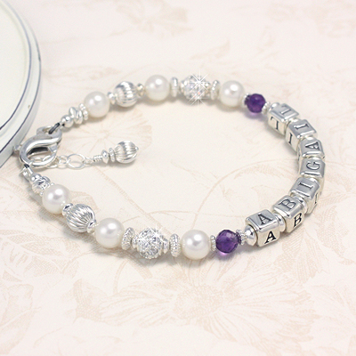 Beautiful birthstone bracelets with cultured pearls and sterling silver. Our birthstone bracelets include a personalized name.