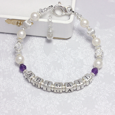 Birthstone bracelets with cultured pearls and sterling silver set with sparkling cz. Mothers jewelry