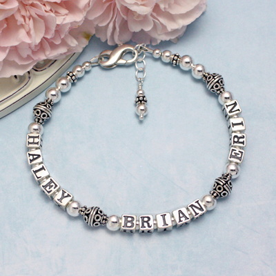 Personalized bracelets in all sterling silver with two or three names. Simple design and beautiful decorative beads.