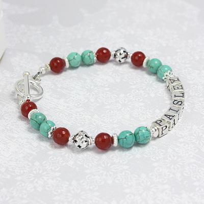 Unique name bracelets in faceted carnelian and green turquoise. The combination is stunning on these mothers bracelets.