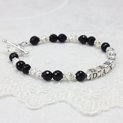 Mothers name bracelets in faceted black onyx and diamond cut sterling. Beautiful name bracelets you can customize.