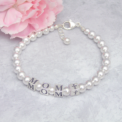 All sterling mothers bracelets with a name and Cross bead. These beaded bracelets are a customer favorite.