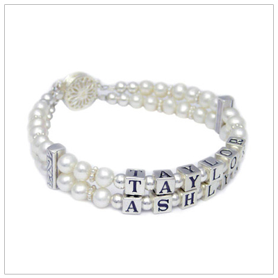 Double strand white cultured pearl mothers bracelets. These mom bracelets have a name on each strand. They are elegant!