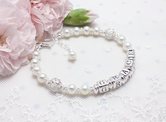 White cultured pearl mothers bracelet with delicate silver filigree beads.