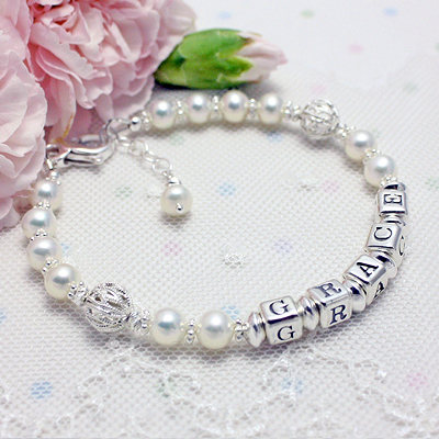 Name bracelets in gorgeous cultured pearls and filigreed silver beads.
