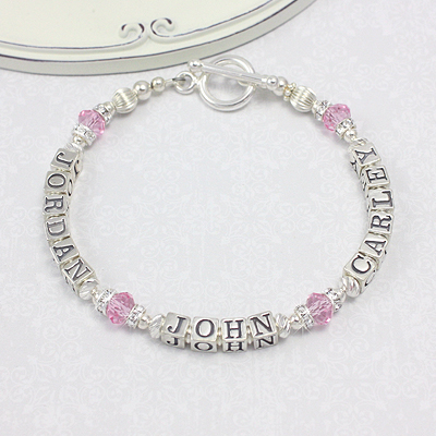 Mothers personalized bracelets in sterling silver and pink crystal cubes. A sparkling personalized bracelet for moms.