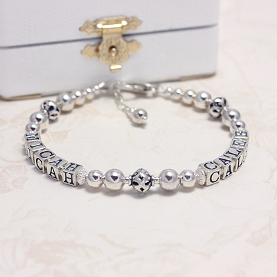 All sterling silver personalized bracelets for mothers. Available with either two or three names.
