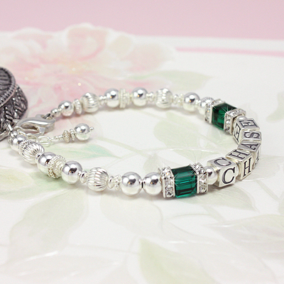 Beautiful personalized bracelets for mothers with cube crystal birthstones topped with sparkling cz in silver.