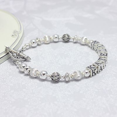 Mothers bracelets in all sterling silver and gorgeous designer beads. These mom bracelets have various options to customize.