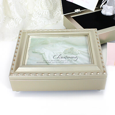 Musical keepsake box for Christening gifts. The keepsake box is champagne silver and fully lined inside; holds personal photo in lid. Tune played is Jesus Loves Me.
