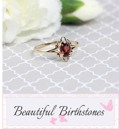14kt gold oval birthstone ring with genuine garnet birthstone.