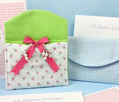 Baby bracelet shown tied to jewelry pouch inner ribbon; method for storing baby jewelry to keep items from damage.