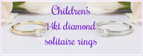 14kt white and yellow gold diamond solitaire rings for children in two sizes.