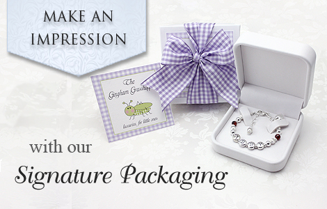 The Gingham Grasshopper's Signature jewelry packaging for baby jewlery.