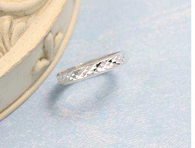 Sterling silver diamond-cut baby ring.