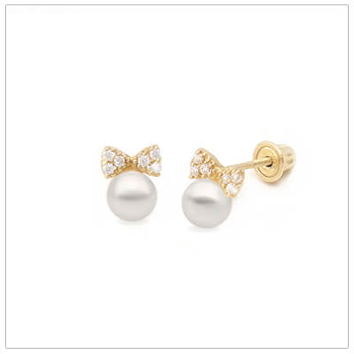 Charming pearl earrings for babies and children topped with 14kt gold bows; the bows are set with clear cubic zirconia. Screw back earrings for children.