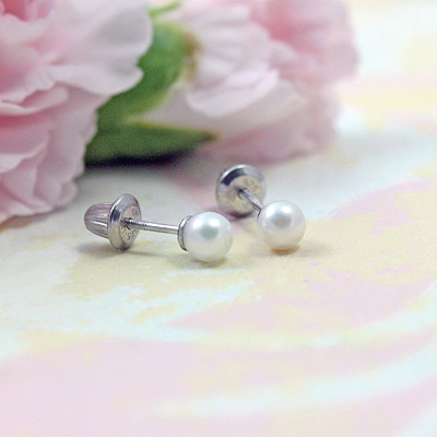 Sterling silver screw back pearl earrings for babies and toddlers.